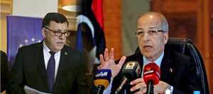 Central Bank of Libya director Alkabeer gestures during a news conference in Tripoli